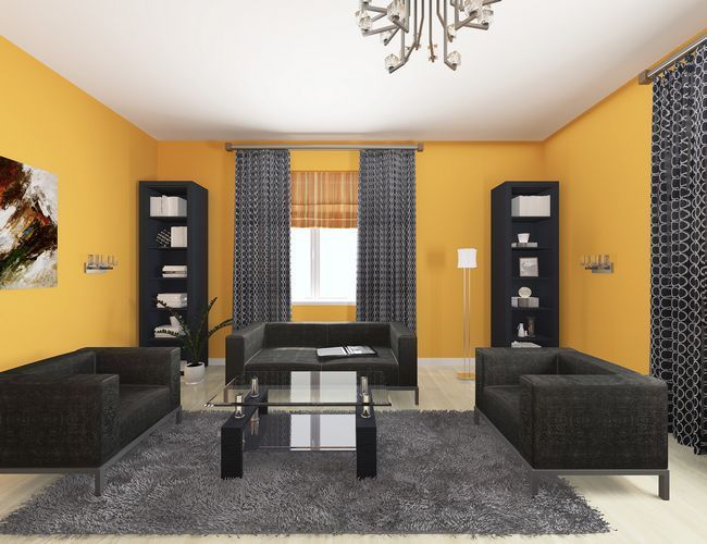 Оранжево-чорна вітальня