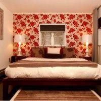 дизайн спальні з шпалерами двох кольорів фото 9